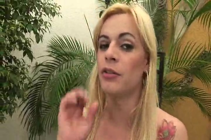 horny blonde with small tits plays with a black dildo