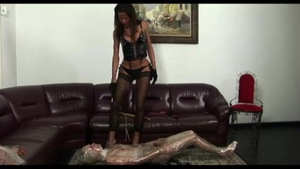 Fetish domination act on a floor