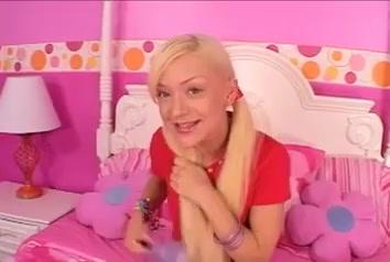 Blonde teen masturbates with her hair brush