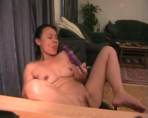 Horny mature muff inserts a huge dildo in her love tube