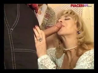 Italian classic porn scene shows a MILF getting facials