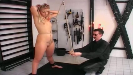 Naughty blonde enjoys some BDSM spanking