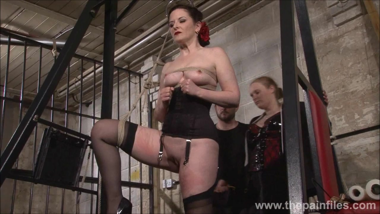 Caroline Pierce whipping and strict double domination punishment of american BDSM model in dungeon bondage and sev