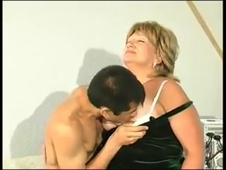 Blonde granny in stockings turns on a junior man