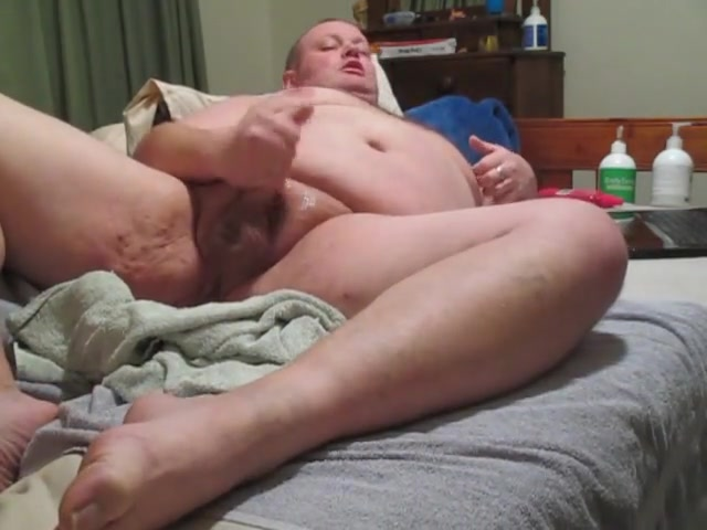 Fat man wanks with a large butt toy inserted