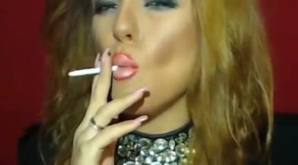 Smoking blonde in heavy makeup long nails