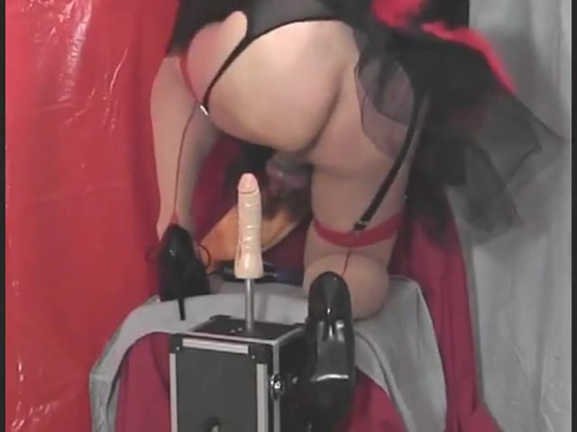 Tiziana dressed as devil plays with her ass
