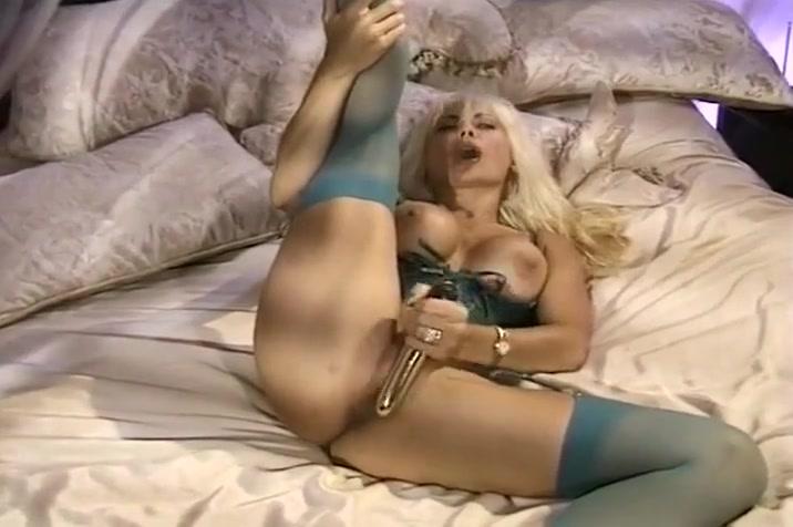 Busty Blond in Corset Masturbating