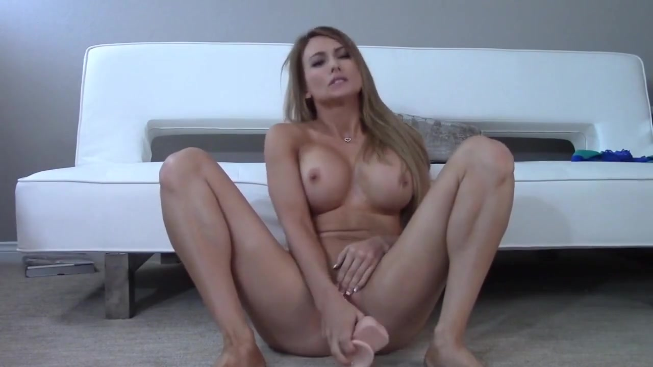 blonde girl with a big dildo fucking her pussy