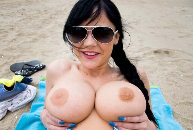 Big tits on the beach