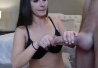 slim brunette playing with a cock and massive balls