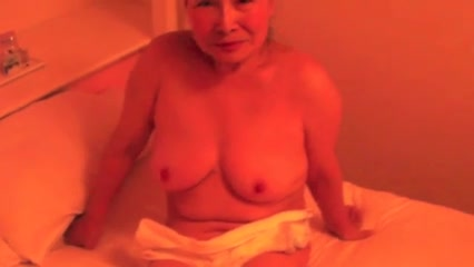 Oriental Granny wench creamed in hotel