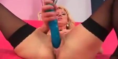 blonde milf in black nylons dildo fucking her pussy