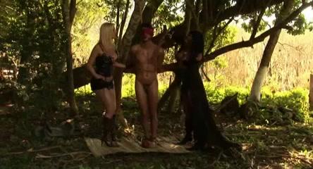 Shemale dominatrix threesome in forest