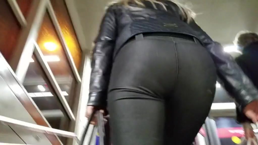 beautiful blonde with small round ass in tight pants