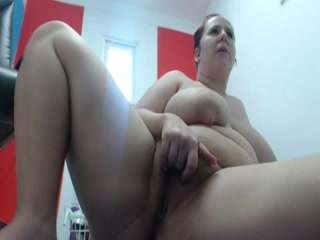 Kinky plumper strips and plays on a webcam