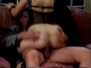 BDSM sex scene with a brunette and two mature guys